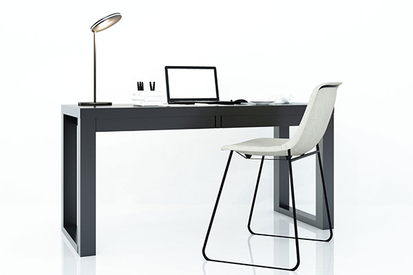 Vacant office desk and chair because the employee is not engaged in their work