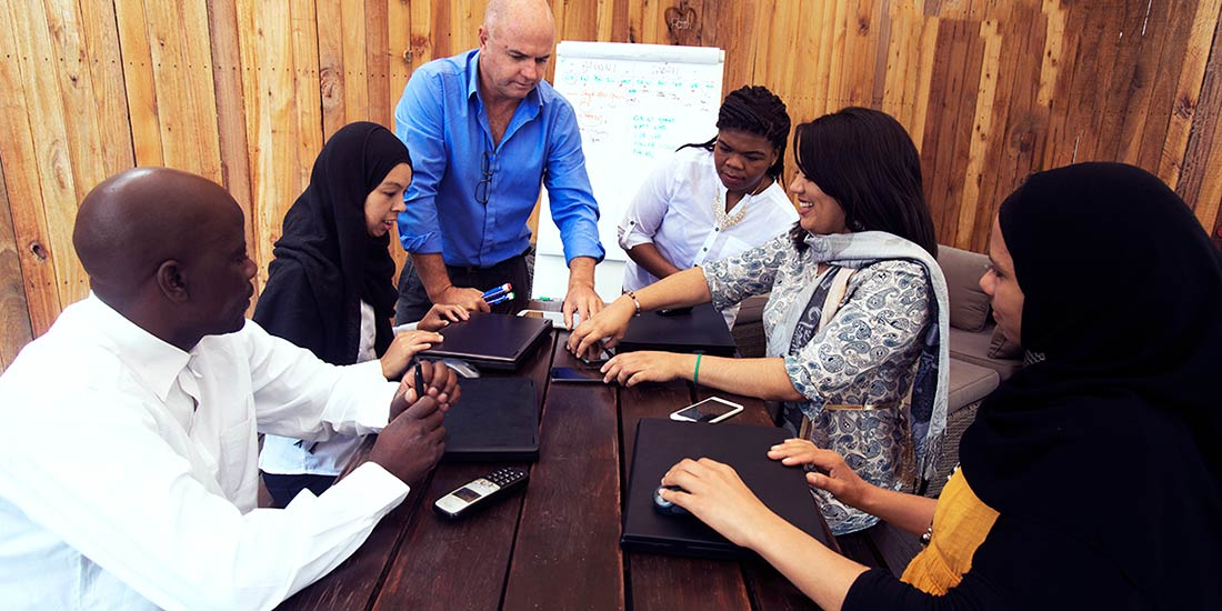 Diverse group of international workers meeting with HR Consultant