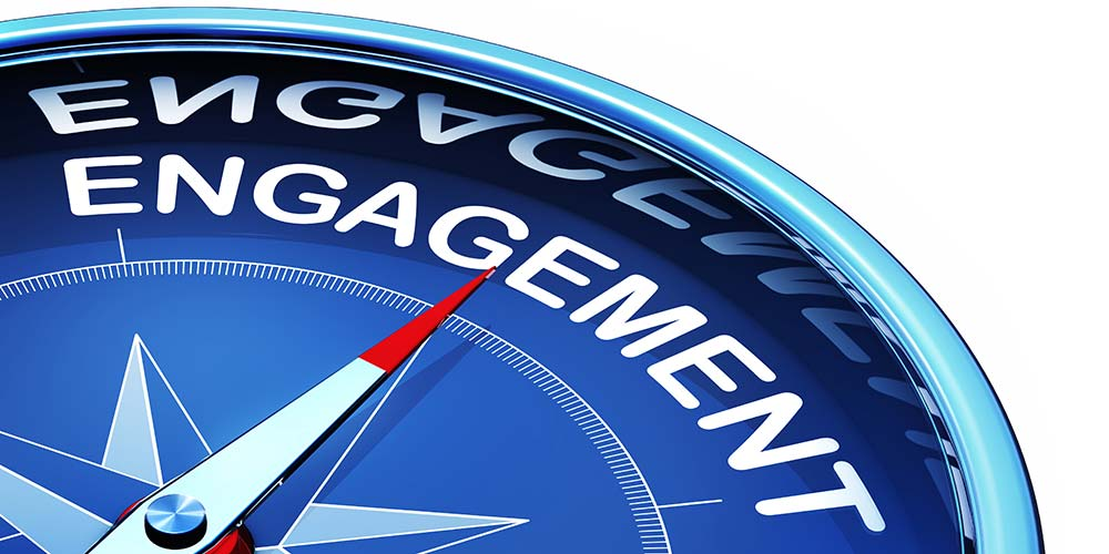 compass that points to the word, Engagement