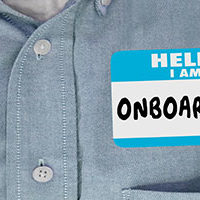 HRCC_journey_employee-with-onboarding-nametag-on-shirtV2